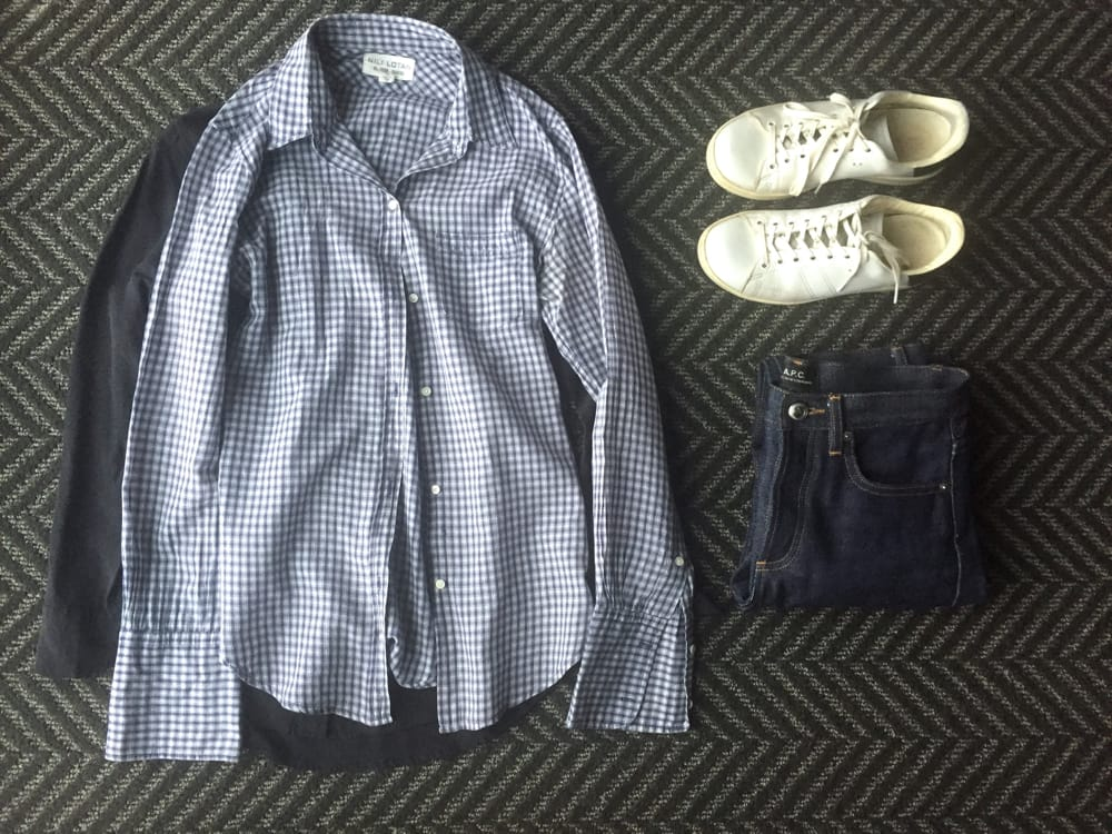 Business casual outfit: Gingham button down, raw jeans, clean sneakers