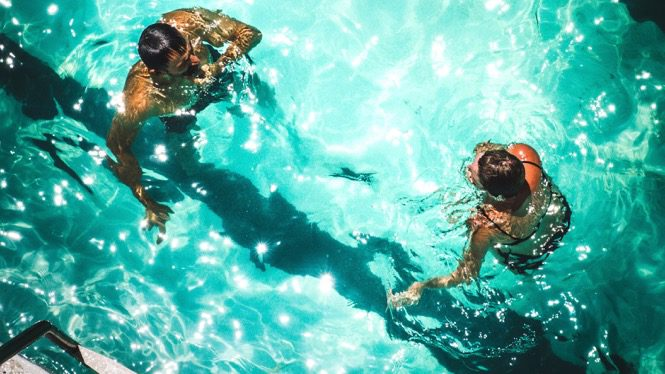 Two people swimming
